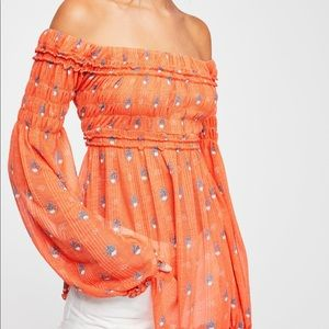 Looking for this top in white and orange!